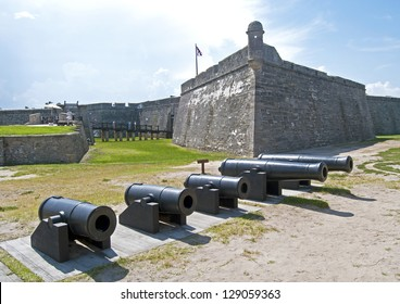 Cannons lined up, walls and field of the Castillo de San Marcos fort in St. Augustine, Florida.