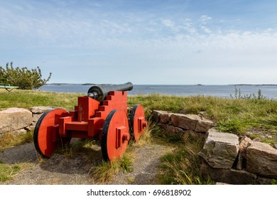 Cannons standing on Odderoya, Kristiansand, Norway. View to the sea, blue sky