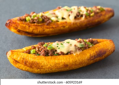 Canoa de Platano (Plantain Canoe) Central American dish, baked plantain stuffed with mincemeat, olive, pepper, onion, cheese, photographed with natural light (Selective Focus one third into image)