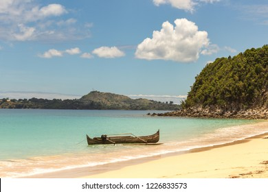 Canoe boat on the beach of Nosy Sakatia island near Nosy Be island Madagascar Africa Indian ocean