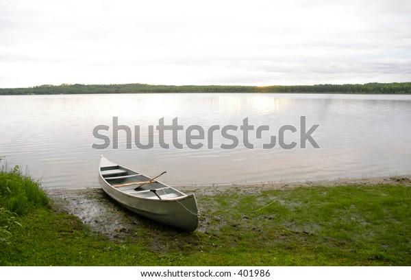 Canoe by a calm lake
