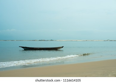 A canoe floating in the water at Oniru Beach, Lagos
