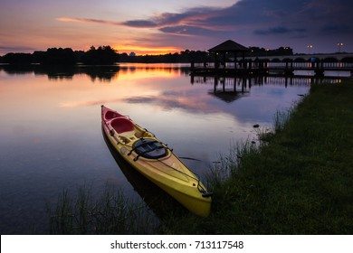 Canoe at the lake during sunset