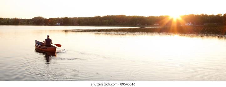 Canoe on Lake with Setting Sun