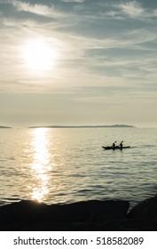 Canoe on Sea at Sunset
