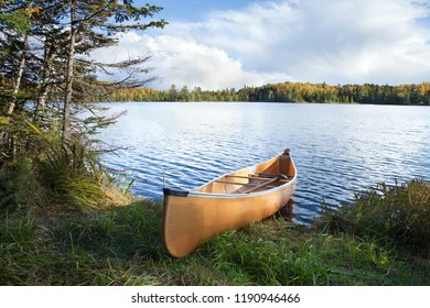 Canoe on the shore of a a beautiful northern Minnesota lake during autumn