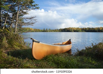 Canoe on the shore of a beautiful northern Minnesota lake during autumn