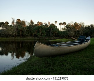 Canoe overlooking a calm river