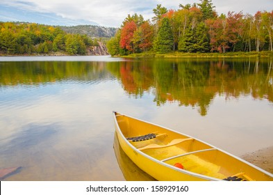 A canoe resting by the calm water in beautiful Killarney, Ontario