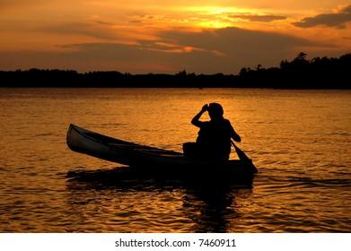 Canoe Silhouette in Sunset on a Minnesota Lake