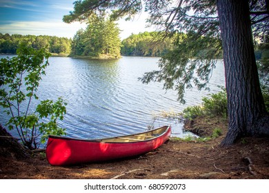 A canoe sitting on a lake in Ontario, Canada.