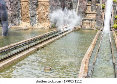 Canoe splashing in theme park water ride