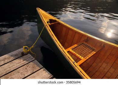 A canoe tied up to a dock.