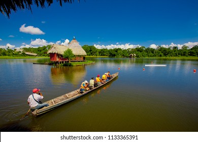 Canoe with tourists crosses the lagoon El Milagro, July 2016.Tingo Maria, Peru.
