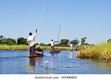 Canoe trip with traditional mokoro boat on the river through Okavango Delta near Maun, Botswana Africa