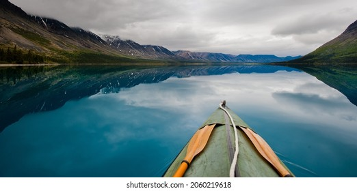Canoe in twin lake. Original public domain image from Flickr