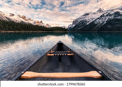 Canoeing with Canadian Rockies in Spirit Island on Maligne Lake at Jasper national park, Canada