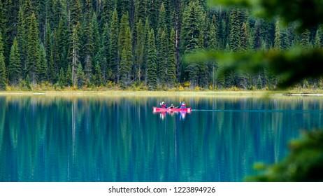 Canoeing family, Emerald Lake, Yoho National Park, British Columbia, Canada.