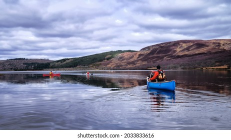 Canoeing and kayaking on Loch Brora in the Highlands of Scotland