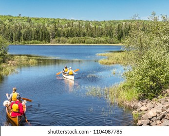 Canoeing on Whitefish Lake near Old Railway Bike Trail during springtime in Algonquin Park, Ontario Canada