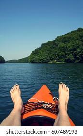 canoeing in summer in a lake in brandenburg, germany