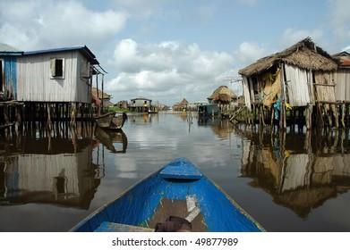 Canoeing through the stilt village of Ganvie in Benin