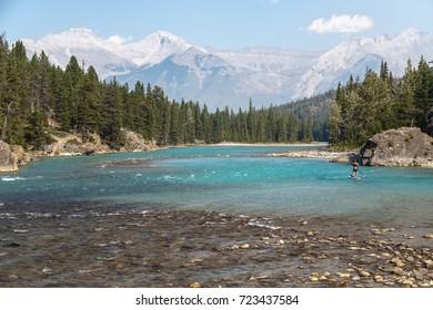Canoers enjoy Banff National Park in Alberta, Canada.