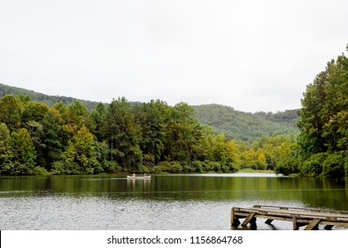 Canoers enjoy a small mountain lake in Virginia on a summer's day.