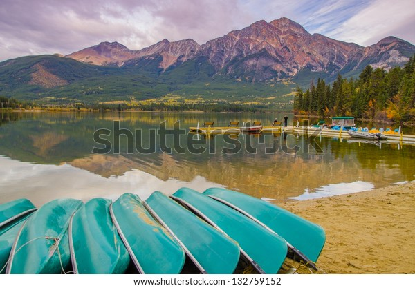 Canoes by the lake in Jasper National Park