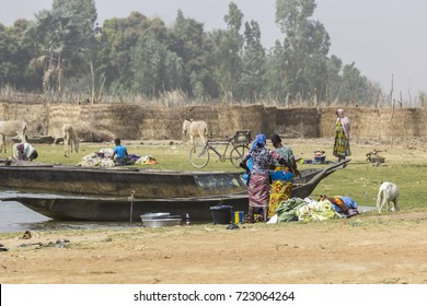 Canoes line the Niger River next to the pottery village of Kalabougou, near Segou, Mali