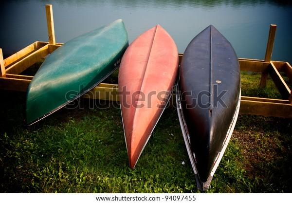 Canoes next to lake in the Carolinas