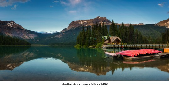 Canoes on beautiful Emerald Lake with lake lodge and restaurant in the background in Yoho National Park, British Columbia, Canada.