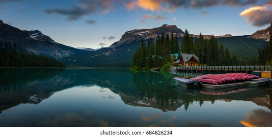 Canoes on beautiful Emerald Lake with lake lodge and restaurant in the background at sunset, Yoho National Park, British Columbia, Canada. Long exposure.