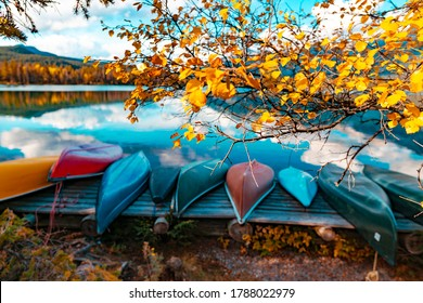 Canoes On Lake In Beautiful Fall Peak Color