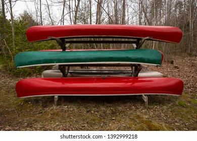 Canoes on a rack at the park.