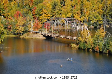 Canoes on the river, Autumn at the Old 510 bridge, Marquette, Michigan USA