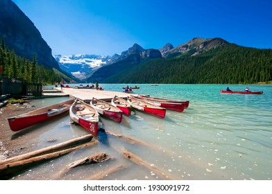 Canoes on the Turquoise waters of Lake Louise in Banff Alberta Canada