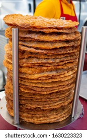 Canoga Park, California / USA -  January 25, 2020: Fried tortilla buñuelo sit ready to eat, coated in sugar, at a booth at the Canoga Park Farmer's Market on Owensmouth Ave.