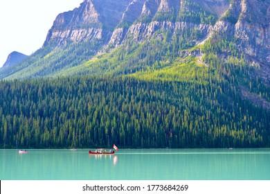 Canoing on the beautiful turquoise blue Lake Louise near Banff Alberta Canada