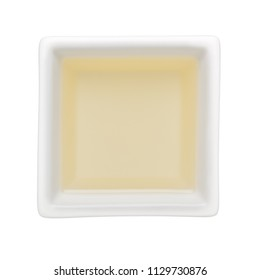 Canola oil in a square bowl isolated on white background