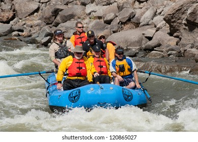 CANON CITY, CO/USA - MAY 19:Colorado State Governor John Hickenlooper (front, center) rafts the site of the Jean Claude/Cristo over the river project on the Arkansas River on May 19,2012 in Canon City