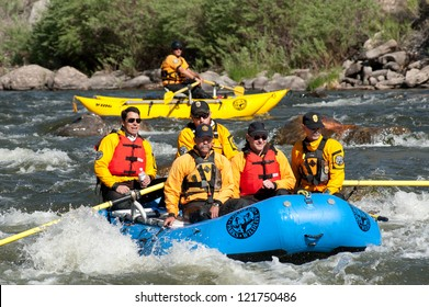 CANON CITY, CO/USA - MAY 19:Colorado State Exec. dir of dept of Interior (back, left) rafts the site of the Jean Claude/Cristo over the river project on the Arkansas River on May 19,2012 in Canon City