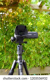 Canon XA11 Camcorder on tripod. High definition camcorder outdoors with nature scenery in background. Edinburgh Scotland. October 2018