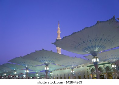 Canopies of Masjid Al Nabawi (Mosque of the Prophet) at sunrise in Medina (City of Lights), Saudi Arabia.Nabawi mosque is Islam's second holiest mosque after Haram Mosque (in Mecca, Saudi Arabia)