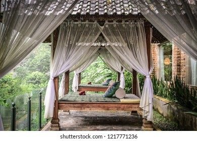 Canopies for massage in resort on Bali island at rainy day