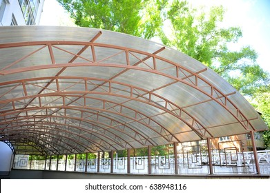 A canopy made of polycarbonate arc . Metal construction.