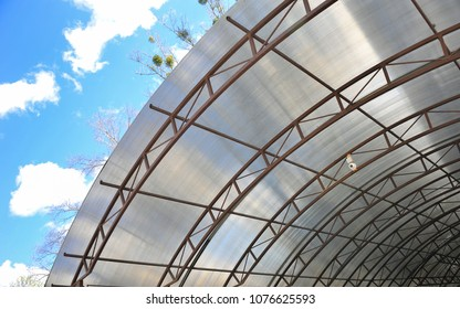 A canopy from polycarbonate arc. Metalware on the blue sky