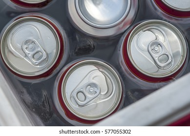 Cans of beer in a bucket of cold water