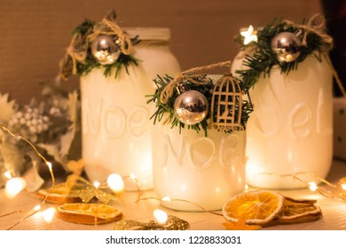 cans with candles with Christmas decoration. candlesticks with hand made. cozy interior decor. Garlands