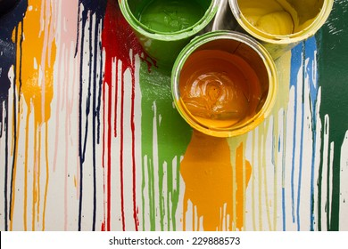 cans and colors drop on the wall for the background